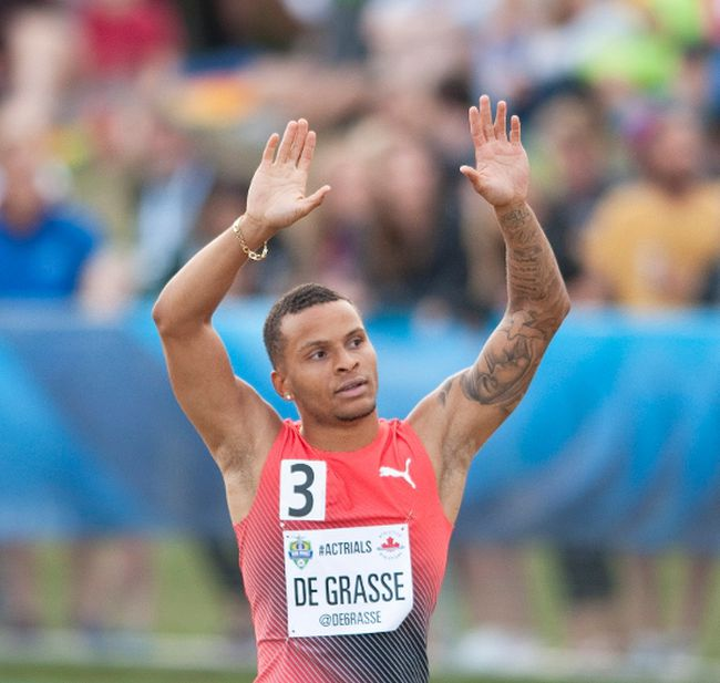 Andre De Grasse reacts after winning the men's 100-metre final at the Canadian Track and Field Championships and Selection Trials for the Olympic and Paralympic Games in Edmonton on July 9, 2016. (THE CANADIAN PRESS/Dan Riedlhuber)