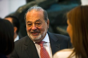 Mexican billionaire Carlos Slim greets attendees before speaking about a new educational application during a news conference at the Museo Soumaya in Mexico City, Wednesday, June 15, 2016. The application, titled Aprende, is free and is currently in use. (AP Photo/Nick Wagner)