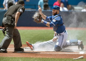 Jays catcher Russell Martin is out after hurting his knee after slipping in the sauna. (CANADIAN PRESS)