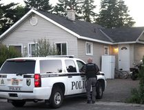 City police keep watch at a home on Carufel Avenue on Friday night. Two male suspects, wanted in relation to a home invasion on Borden Avenue on Thursday morning, were arrested. No other information was available at press deadline.
