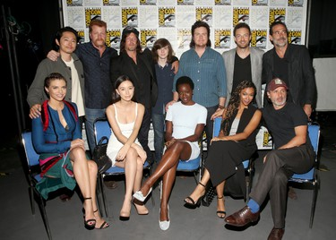 SAN DIEGO, CA - JULY 22:  (L-R, top) Actors Steven Yeun, Michael Cudlitz, Norman Reedus, Chandler Riggs, Josh McDermitt, Ross Marquand, Jeffrey Dean Morgan (bottom) Lauren Cohan, Christian Serratos, Danai Gurira, Sonequa Martin and Andrew Lincoln attend attend AMC's 'The Walking Dead' panel during Comic-Con International 2016 at San Diego Convention Center on July 22, 2016 in San Diego, California.  (Photo by Jesse Grant/Getty Images for AMC)