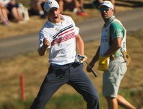 Jared du Toit reacts after sinking an eagle on 18 at the 2016 Canadian Open in Oakville, Ont., on Saturday, July 23, 2016. (Nathan Denette/The Canadian Press)