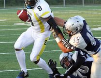 Sudbury Spartans linebacker Andrew Gillis (42) gets hold of the jersey of Sault Steelers ball carrier Alanzo Clarke during Northern Football Conference action at James Jerome Sports Complex in Sudbury on Saturday, July 23, 2016. Ben Leeson/The Sudbury Star/Postmedia Network