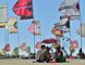 There friends share the shade of an umbrella as they wait between sets during the WayHome Music and Arts Festival Saturday.  Mark Wanzel/Barrie Examiner/Postmedia Network