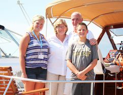 A proud family stands aboard the Black Beauty with its mirror-finish mahogany hull. The 1957 Chris-Craft was among the boats displayed during the annual Antique and Classic Boat Show Saturday at the Sarnia Bay Marina. Rick and Diane Laenen came to the the show from St. Clair, Mich. with grandchildren Emilee and Andrew. (Neil Bowen/Sarnia Observer)