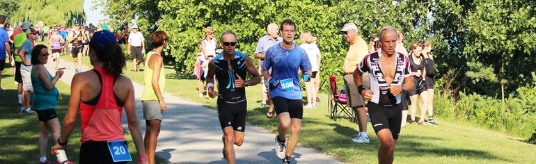 Runners in the Bluewater Triathlon beat the temperature challenge during Saturday's event in Bright's Grove. (Neil Bowen/Sarnia Observer)