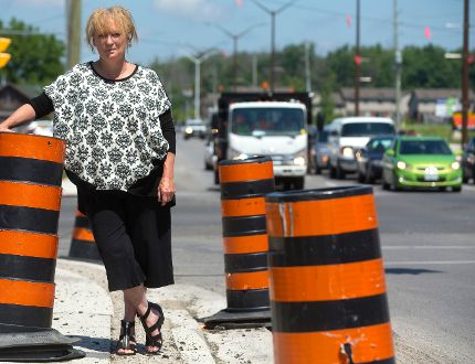 Donna Szpakowski, the president of the Hyde Park business association will be glad to see the end of construction pylons as after two years of construction during the widening of Hyde Park road the construction will come to an end next week in London. (MIKE HENSEN, The London Free Press)