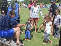 """Ferg Devins, left, asks young children to tell stories about camping, fishing or any fun activities during the summer at the Eighth """"Maybe Annual"""" Coney Island Music Festival on Sunday, July 24. PHOTOS BY DANELLE GRANGER/Daily Miner and News"""