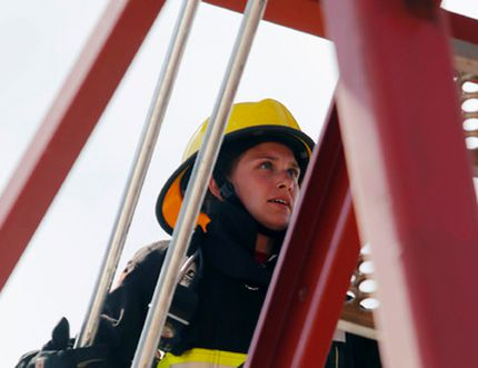 Volunteer firefighter Jocelyn Brethour charges up the tower stairs while competing in a relay race of the Belleville Firefit southern Ontario regional championship in Belleville Sunday. She's the Belleville Fire Department's first female Firefit athlete and it was her debut contest.