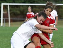 Chatham Eagles' Elise Johnston, right, battles for the ball against North London Galaxy's Joanne Nielsen in the first half of their London & Area Women's Soccer League game Saturday at Thames Campus. Lindsay Harrop scored for the Eagles in a 2-1 loss that dropped their record to 2-5-2 in the Premier Division. (MARK MALONE/The Daily News)