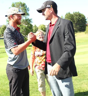 Last year's Seaforth Country Club Classic champion, David Markle shakes hands with the new champion, Michael Gligic.(Shaun Gregory/Huron Expositor)