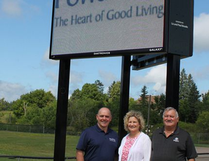 Powassan Mayor Peter McIsaac, Liz Brooks and Paul Brooks appear with the community's new digital sign. Submitted Photo