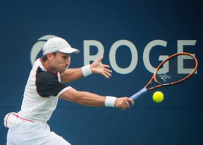 Steven Diez of Canada returns the ball to Kyle Edmund of Great Britain during first-round Rogers Cup action in Toronto on Monday, July 25, 2016. (THE CANADIAN PRESS/Nathan Denette)