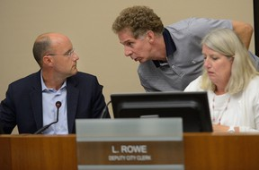 Mayor Matt Brown, Deputy Mayor Paul Hubert, and Deputy Clerk Linda Rowe confer during a debate on whether to elect a second deputy mayor to replace Maureen Cassidy at London city hall Monday. (MORRIS LAMONT, The London Free Press)
