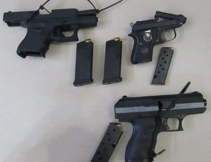 Border services officers at the Prescott port of entry found three loaded handguns during two separate searches on the same day.