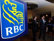 Shareholders leave the Royal Bank of Canada annual meeting, in Calgary, on Feb. 28, 2013. (THE CANADIAN PRESS/Jeff McIntosh)