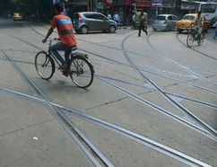 A cyclist pedals across train lines. Getty Images