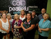 Emily Mountney-Lessard/The Intelligencer Participants of a suicide bereavement group, hosted by the Canadian Mental Health Association, pose for a photo prior to their meeting on Tuesday in Belleville.
