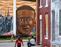 A mural depicting Freddie Gray is seen past blighted row homes in Baltimore, Thursday, June 23, 2016, at the intersection where Gray was arrested. (AP Photo/Patrick Semansky)