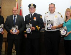 From left, Pierre Potvin, area operations supervisor at Enbridge, poses with Brockville acting mayor Phil Deery, chief fire prevention officer Greg Healy, fire chief Ghislain Pigeon and Kathy Ash, of the Fire Marshal's Public Fire Safety Council, during a presentation at city council's regular meeting on Tuesday. (RONALD ZAJAC/The Recorder and Times)