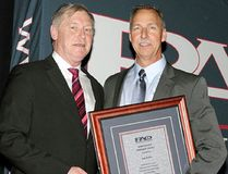 Const. Pete Bakker, right, of the Chatham-Kent Police Service is pictured receiving the John Walker Award from Bruce Chapman, president of the Police Association of Ontario, during the PAO's spring conference in recognition of Bakker's 14-year tenure as president of the CKPS police association. (Handout/Chatham Daily News)