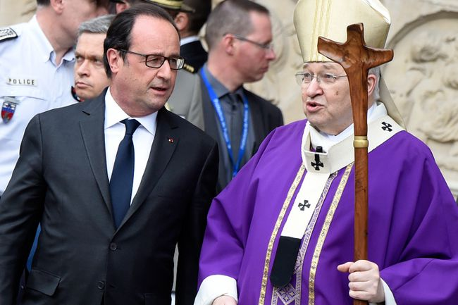 French President Francois Hollande (L) talks with French Cardinal Andre Vingt-Trois (R) after a Mass at the Notre Dame Cathedral in tribute to the priest Jacques Hamel, killed on July 26 in his church of Saint Etienne du Rouvray during a hostage-taking claimed by Islamic State group, in Paris on July 27, 2016. France probes an attack on a church in which two men described by the Islamic State group as its 'soldiers' slit the throat of a priest. An elderly priest had his throat slit in a church in northern France on July 26 after two men stormed the building and took hostages. The attack in the Normandy town of Saint-Etienne-du-Rouvray came as France was still coming to terms with the Bastille Day killings in Nice claimed by the Islamic State group. / AFP / DOMINIQUE FAGET (Photo credit should read DOMINIQUE FAGET/AFP/Getty Images)