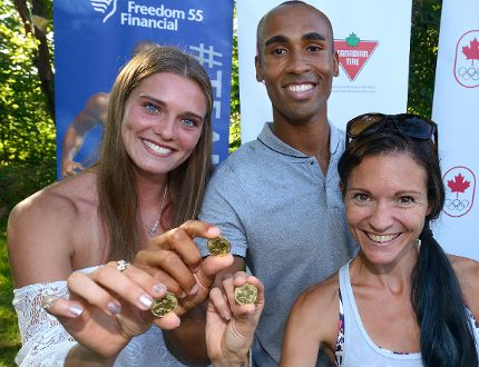 London Olympians Alysha Newman, left, Damian Warner and Lanni Marchant flash lucky loonies at an Olympics sendoff bash this week in London. Newman will be pole vaulting on Central Avenue today, a sideshow to Ribfest. (MORRIS LAMONT, The London Free Press)