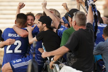 Edmonton's Daryl Fordyce (second from left) celebrates his game-winning goal with fans and players during NASL soccer play between FC Edmonton and the New York Cosmos at Clarke Stadium in Edmonton, on Wednesday, July 27, 2016. Ian Kucerak / Postmedia