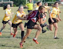 The pulling of a shirt will not stop Abbey Anderson of the Norfolk Harvesters from running down the pitch during a Niagara Rugby Union U18 women's game against the visiting Niagara Wasps Wednesday in Waterford. Niagara defeated Norfolk 37-7. (EDDIE CHAU Simcoe Reformer)