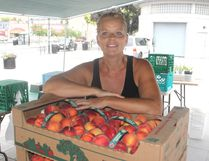 <p>Lisa Davis from Napanee was at a stall at the downtown farmers' market in Kingston, Ont. on Thursday, July 28, 2016. Local farmers and their crops are feeling the effects of the hot dry days this summer. Michael Lea The Whig-Standard Postmedia Network