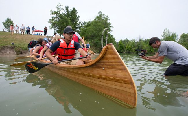 Chippewas Of The Thames First Nation Youth Kingston Huff Paddles Away From Shore In A Canoe Which He Helped Build At Naming And Launch Ceremony