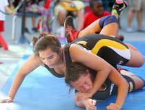 Jayden Ramgotra (l) takes down Jenna Popowich during a wrestling demonstration at the one year kickoff for the Canada Summer Games in Winnipeg, Man. Thursday July 28, 2016. Brian Donogh/Winnipeg Sun/Postmedia Network