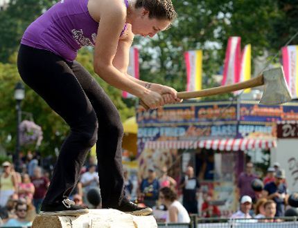 Caitlin Carroll, of Truro Nova Scotia, competes in the Stihl Timbersports 2016 Canadian Championships on Thursday, part of this year's Rifest at Victoria Park in London. (MORRIS LAMONT, The London Free Press)