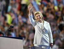 Democratic presidential nominee Hillary Clinton waves on stage during the fourth and final night of the Democratic National Convention at Wells Fargo Center on July 28, 2016 in Philadelphia, Pennsylvania. / AFP PHOTO / Nicholas KammNICHOLAS KAMM/AFP/Getty Images