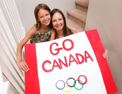 Kailah Tetreault, 10, left, and her mom April with an Olympic poster that Kailah made in Shallow Lake. The pair will take the poster with them to the summer Olympics in Rio de Janeiro. (JAMES MASTERS/SUN TIMES)