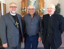 Supplied Bishop Larry Kochendorfer (left) congratulates President Philip Kildal and Pastor David Friesen, on the 100th Anniversary of Calvary Lutheran Church (LaGlace).