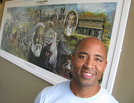 File photo/ Postmedia Network Steven Cook, site manager at Uncle Tom's Cabin Historic Site near Dresden, with a mural depicting 19 images from the life of Rev. Josiah Henson, founder of the Dawn Settlement at Dresden and author of an autobiography that helped inspire Harriet Beecher Stowe to write the 1852 novel, Uncle Tom's Cabin. The historic site on Saturday will be marking Emancipation Day, when slavery was abolished in Canada in 1834. Admission to the site will be free.