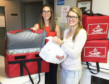 Submitted photo Shell Canada summer students Sandra Lunn and Maddi Basso assist the United Way and many funded programs and services while their salary and other costs are paid for by Shell. In this photo the Shell students are helping with Meals on Wheels, but have also done a number of things with the Red Cross, Lambton Seniors, the Salvation Army, and the United Way, as it prepares to launch its 2016 campaign on Sept. 13.