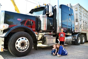 Perth Care for Kids held its 6th annual Big Wheel Little Drivers event in the Mitchell & District Arena parking lot July 23, where kids of all ages got a chance to get a closer look at some of the big vehicles from all over West Perth. Pictured, Piper and Mya Thomson, and Liam Hunt pose for a picture with an enormous (by comparison) livestock truck. In total, organizers guessed that 450 people attended despite the hot, humid weather conditions. After all, who can resist a big truck? GALEN SIMMONS/MITCHELL ADVOCATE