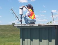 Submitted photo A Lower Trent Conservation staffer works on one the of the conservation authority's nine water gauges. Little rain continues to be an issue across local area watersheds.