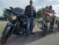 Lake Huron Steel Horse Riders patch members, from left, Steve Small and Brenda Brown, and owner of Smiley & Company Custom Motorcycles, Mike Smiley, are hoping to make the roads safer for local motorcycle enthusiasts through adopting the section of Concession 6 that has downed four of the clubs riders in as many years as well as put up signs to advertise the road's dangerous S-bend turn. (Darryl Coote/Kincardine News)