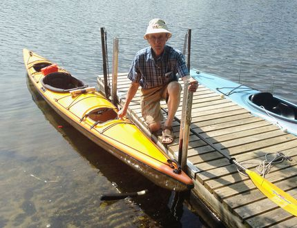 <p>Ralph Wirsig demonstrates how his invention, the KayaArm, creates a stable platform for getting in and out of a kayak at his home on Buck Lake north of Kingston, Ont. on Friday, July 7, 2016. </p><p>Elliot Ferguson/The Whig-Standard/Postmedia Network