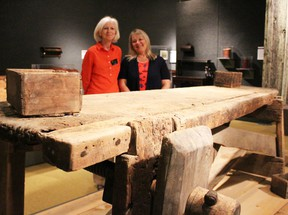 Assistant curator Fran Nichol and curator Lois Gilmou, of the Lambton Heritage Museum, are pictured here with the workbench of early Lambton carpenter John McElroy. The museum is currently hosting the Made in Lambton carpentry exhibit. Barbara Simpson/Sarnia Observer/Postmedia Network