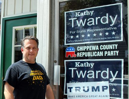Charlie Pinkerton/Special to The Sault Star Anthony Stackpoole, chairman of the Chippewa County Republican Party, outside of his coffee shop, Cup of the Day in Sault Ste. Marie, Mich.