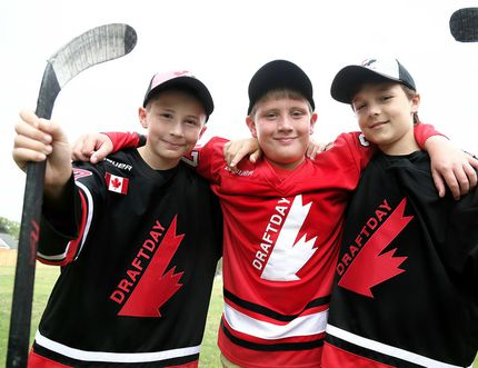 Rorey Elson, left, Jake Vancoillie and Declan Waddick are going to Finland and Sweden for the Warrior Elite Series Europe hockey tournament in August. Chatham-Kent Cyclones teammate Matt Thomas, not pictured, is also playing with them on the Draftday North America team. (MARK MALONE/The Daily News)