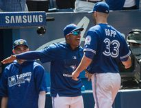 Blue Jay Marcus Stroman meets J.A. Happ at the dugout. Toronto Blue Jays starter J.A. Happ gets the win against the Baltimore Orioles, putting the Jays in first place in the AL East in Toronto, Ont. on Saturday July 30, 2016. Craig Robertson/Toronto Sun/Postmedia Network