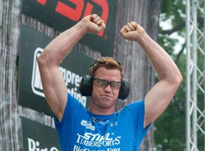 Stirling Hart, of Vancouver, throws his arms in the air in celebration after making two clean cuts with his chainsaw in the hot saw contest at the Stihl Timbersports Canadian Championship in Victoria Park in London, Ont. on Sunday July 31, 2016. Hart was named Canadian Champion following four days of competition.  Craig Glover/The London Free Press/Postmedia Network