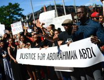 Demonstrators shout and chant for justice as they arrive at Ottawa Police headquarter during the March for Justice - In Memory of Abdirahman Abdi. Saturday, July 30, 2016. (James Park, Postmedia Network)
