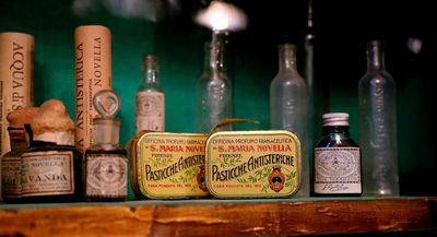 A selection of antique pills that promised to cure hysteria-related complaints, at the Santa Maria Novella pharmacy in Florence, Italy. Founded by Dominican friars in the 13th century, you can't buy the pills today, but you can find a wide variety of perfumes and other products. (Michelle Locke via AP)