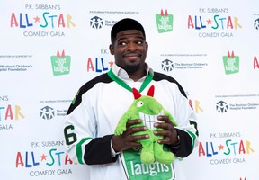 Nashville Predators defenceman P.K. Subban hams it up with a stuffed mascot during a news conference in advance of the P.K. Subban All-Star Comedy Gala, Monday, Aug. 1, 2016, in Montreal. (THE CANADIAN PRESS/Paul Chiasson)